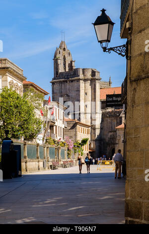 Pontevedra , Spain - May 12, 2019: Tourists and pilgrims roam the streets where magnificent buildings are situated in the historic Spanish city, Ponte - Stock Photo