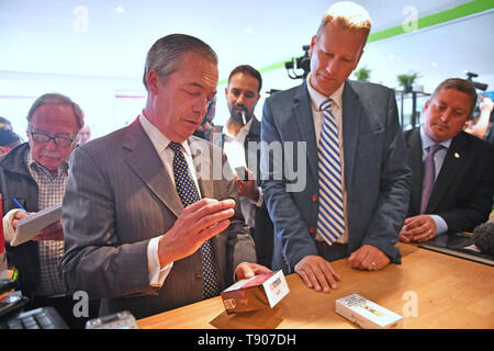 Brexit Party leader Nigel Farage visits a vape shop with the party's lead candidate in Wales, Nathan Gill, during a walkabout in Merthyr Tydfil. - Stock Photo
