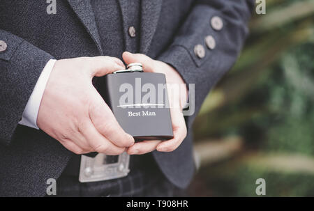 Best Man with hip flask - Stock Photo