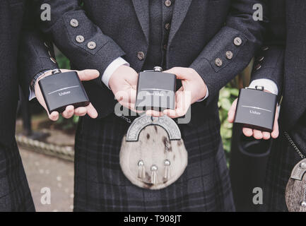 Best Man and ushers with hip flasks - Stock Photo