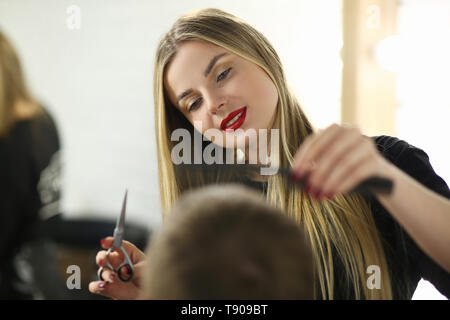 Young Hairdresser Cutting Male in Beauty Salon - Stock Photo