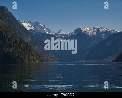 View on the snow-covered mountains and the church St. Bartholomä at the Königssee in Berchtesgaden - Stock Photo
