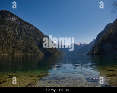 View from the Malerwinkel onto Königssee with the church St. Bartholomä at Königssee - Stock Photo