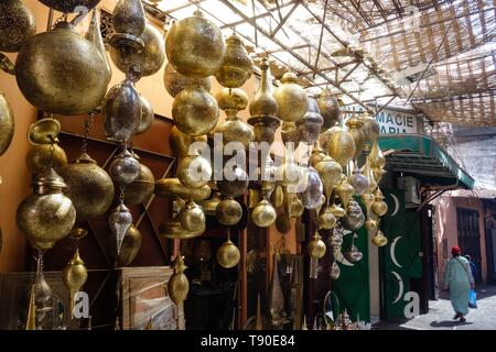 Golden, decorative moroccan style laterns, hanging on the bazaar in the medina in Marrakesh, Morocco - Stock Photo