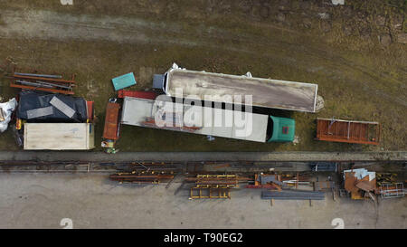Scrap machinery and trucks on yard, top down aerial view - Stock Photo