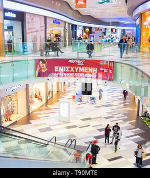 PAHOS, CYPRUS - FEBRUARY 14, 2019: People in shopping center, modern interior design of Kings Avenue Mall with escalator among floors - Stock Photo