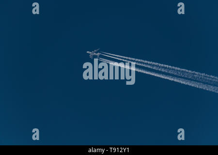 Airbus A380 which is a four-engine jet airliner flying at altitude with contrail from the four engines, Air France aircraft - Stock Photo
