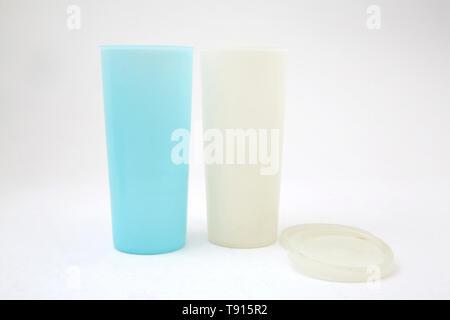 Vintage Tupperware Beakers and Lids - Stock Photo