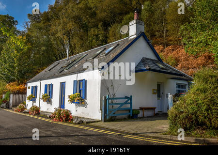 Old Cottage by Loch Lomond at Balmaha in the Scottish sunshine on a beautiful morning. - Stock Photo