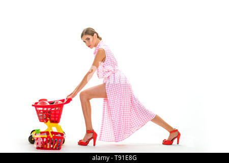 woman going to make payment in supermarket. shopping girl with full cart. savings on purchases retro woman go shopping. vintage housewife woman - Stock Photo