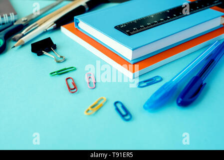 School supplies on blue background. Close up.