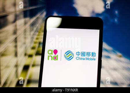 May 14, 2019 - GlóRia De Dourados, Mato Grosso do Sul, Brazil - In this photo illustration the China Mobile (CMCC) logo seen displayed on a smartphone. Credit: Rafael Henrique/SOPA Images/ZUMA Wire/Alamy Live News - Stock Photo