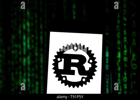 May 14, 2019 - GlóRia De Dourados, Mato Grosso do Sul, Brazil - In this photo illustration the Rust logo seen displayed on a smartphone. Credit: Rafael Henrique/SOPA Images/ZUMA Wire/Alamy Live News - Stock Photo