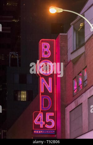 New York City, USA: Bond 45 restaurant neon sign outside the premise in Midtown. Bond 45 New York is an Italian Steakhouse, Seafood Restaurant and NYC - Stock Photo