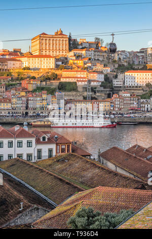 Sunset over Ribeira district and former Episcopal Palace, Unesco World Heritage Site, OPorto, Portugal - Stock Photo
