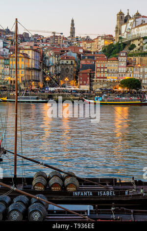 Sunset over Ribeira district and the Douro with Rabelos, Unesco World Heritage Site, OPorto, Portugal - Stock Photo