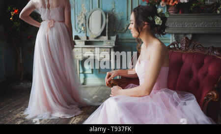 Bride and bridesmaids. Young beautiful women in pink wedding dresses, wedding fashion. - Stock Photo