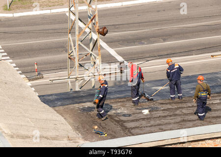 Kremenchug, Poltava region, Ukraine, April 23, 2019, repair of the old roof of the building, the roof is covered with new ruberoid - Stock Photo