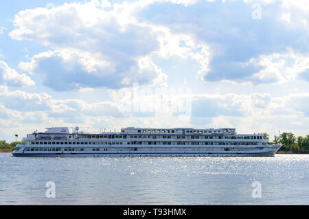 Kremenchug, Ukraine - May, 5, 2019. 'Viking Sineus' - a four-deck passenger riverboat  on the Dnieper River near the city of Kremenchug. - Stock Photo
