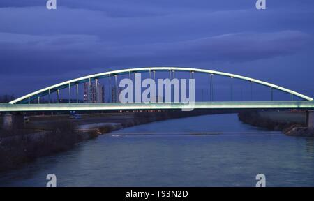 Illuminated train bridge over river Sava in Zagreb - Stock Photo