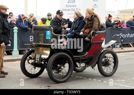 Ms Mary Crofton being interviewed, after successfully completing the 2018  London to Brighton veteran Car Run, driving a 1900, De Dion Buton. - Stock Photo