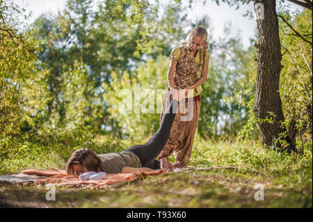 Massage and aromatherapy women on the ground with a healer. - Stock Photo