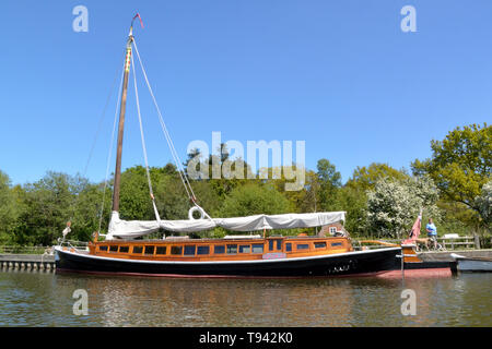 Historic pleasure wherry Hathor moored at How Hill, River Ant, Broads National Park, Norfolk, UK - Stock Photo