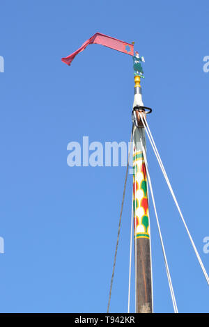 Jenny Morgan on the mast of historic pleasure wherry Hathor moored at How Hill, River Ant, Broads National Park, Norfolk, UK - Stock Photo