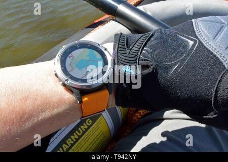 Garmin fenix 5 Plus being used to navigate a kayak across Barton Broad, Broads National Park, Norfolk, UK - Stock Photo