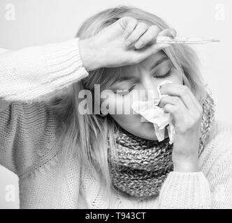 Measure temperature. Break fever remedies. Seasonal flu concept. Woman feels badly. Fever symptoms and causes. Sick girl with fever. How to bring fever down. Girl sick hold thermometer and tissue. - Stock Photo