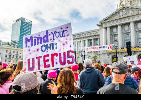 January 19, 2019 San Francisco / CA / USA - Participant to the Women's March event holds 'Mind your own uterus' sign at the rally held in front of the - Stock Photo