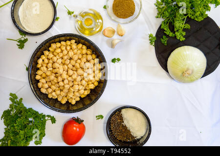 Flat lay, ingredients for cooking falafel, food from Egypt. Chickpeas, herbs and spices, concept for middle eastern, Arabic cuisine, restaurants, menu - Stock Photo