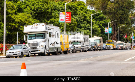 May 9, 2019 Palo Alto / CA / USA - Campers and RVs parked on the side of El Camino Real, close to Stanford in San Francisco bay area, Silicon Valley;  - Stock Photo