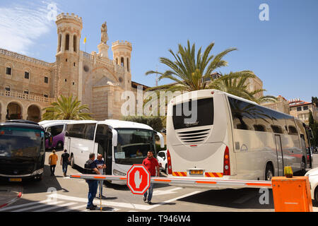 JERUSALEM - APRIL 27, 2019:  Tourist buses in front of Notre Dame of Jerusalem, hotel for christian pilgrims coming to Holy land. - Stock Photo
