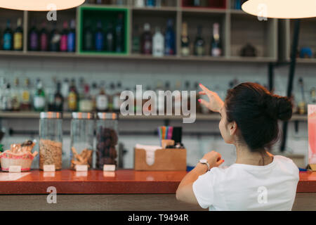 young attractive woman makes an order in a cafe
