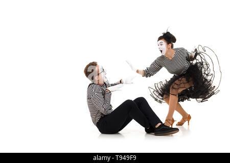 Smiling mimes in striped shirts. Man and woman dressed as actors of pantomime theater isolated on white background - Stock Photo
