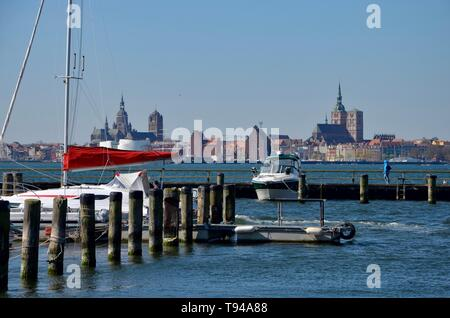 Island Ruegen in Germany, Mecklenburg West Pomerania, Baltic sea, harbor of the spa town Altefaehr,view to the skyline of the hanseatic city Stralsund - Stock Photo