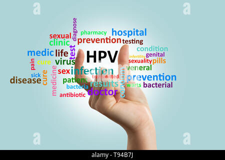 Woman doctor showing with fingers hpv word on invisible glass screen as informing concept closeup - Stock Photo