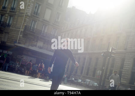 A local business man strolling and walking in the city centre of Paris exploring the city and its sights - Stock Photo