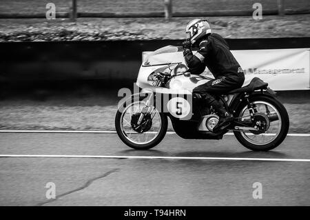 A classic motorbike on the track at Goodwood Revival 2017 - Stock Photo