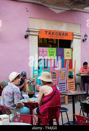 Latin America food - people eating at a taco bar cafe outside, Campeche old town UNESCO world heritage site, Campeche Mexico, Latin America - Stock Photo