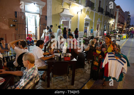 Mexico tourists - people eating outdoors at street restaurants and cafes in the evening, Campeche old town UNESCO world heritage site, Campeche mexico - Stock Photo