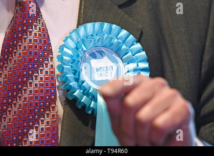 A rosette on the jacket of Brexit Party leader Nigel Farage at Sugar Hut in Brentwood, Essex, while on the European Election campaign trail. - Stock Photo
