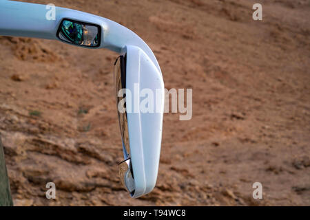 Wing mirror on a touring coach - Stock Photo