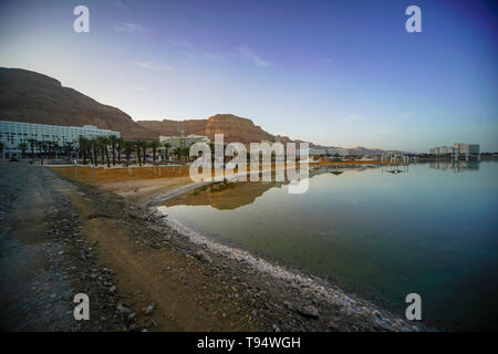 Hotels and a reflection in the Dead Sea, Israel as seen from south - Stock Photo
