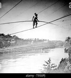 Entitled: 'Blondin carries manager Harry Colcord on back over Niagara Falls.' Charles Blondin (born Jean François Gravelet, February 28, 1824 - February 22, 1897) was a French tightrope walker and acrobat, called the 'Chevalier Blondin', or simply 'The Great Blondin'. At the age of five he was sent to the École de Gymnase at Lyon and, after six months training as an acrobat, made his first public appearance as 'The Boy Wonder'. His superior skill and grace, as well as the originality of the settings of his acts, made him a popular favorite. He is most remembered for crossing the Niagara Gorge  - Stock Photo