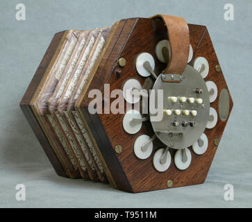 A concertina made by Charles Wheatstone (1802-1875) in London, England between 1831 and 1837. The concertina was invented in England and Germany, most likely independently. The English version was invented in 1829 by Sir Charles Wheatstone, while Carl Friedrich Uhlig announced the German version five years later, in 1834. Apart from the concertina, Charles Wheatstone invented the stereoscope (a device for displaying three-dimensional images), and the Playfair cipher (an encryption technique). - Stock Photo