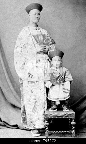 Chang Yu-sing the Chinese giant, and Chung Mow, a dwarf. Zhan Shichai AKA Chang Woo Gow (1841/47 - November 5, 1893) was a Chinese giant. His height was claimed to be over 8 feet, but there are no authoritative records. He left China in 1865 to travel to London where he appeared on stage, later travelling around Europe, and to the US and Australia as 'Chang the Chinese Giant'. Zhan received a good education in various countries, and developed a good understanding of ten languages. - Stock Photo