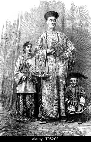 Chang Yu-sing the Chinese giant, with his wife, King-Foo and Chung Mow, a dwarf. Zhan Shichai AKA Chang Woo Gow (1841/47 - November 5, 1893) was a Chinese giant. His height was claimed to be over 8 feet, but there are no authoritative records. He left China in 1865 to travel to London where he appeared on stage, later travelling around Europe, and to the US and Australia as 'Chang the Chinese Giant'. - Stock Photo