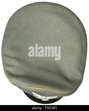 A visor cap for enlisted men/NCOs in Cavalry Regiment 6 Private purchase piece in fine field-grey woollen cloth, dark green trim band, golden-yellow piping, beige silk liner, the cap trapezoid (damaged) with maker's imprint 'H.Krätschmer Göttingen Straße der SA 10', brown leather sweatband, aluminium insignia, fire-gilt Schwedt eagle in non-ferrous metal, black patent leather straps. Signs of usage, light signs of age. historic, historical, army, armies, armed forces, military, militaria, object, objects, stills, clipping, clippings, cut out, cut-out, cut-outs, 20th century, Editorial-Use-Only - Stock Photo
